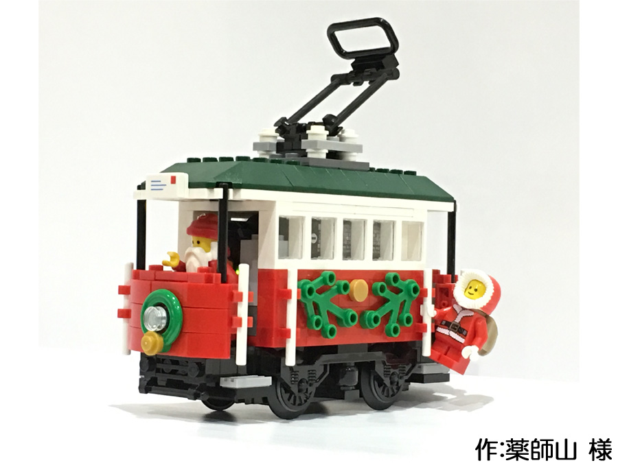 薬師山様作のホリデートラム。サンタと弟子が路面電車でプレゼントを運びます。