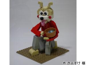 お餅を返す赤い袴の犬。立ち膝で臼を見守ります。