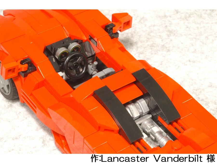 赤いスーパーカーを上から。ガラスを外すと、運転席やエンジンまで作りこまれています。